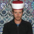 An Imam Lend Guy His Hat For A Photo