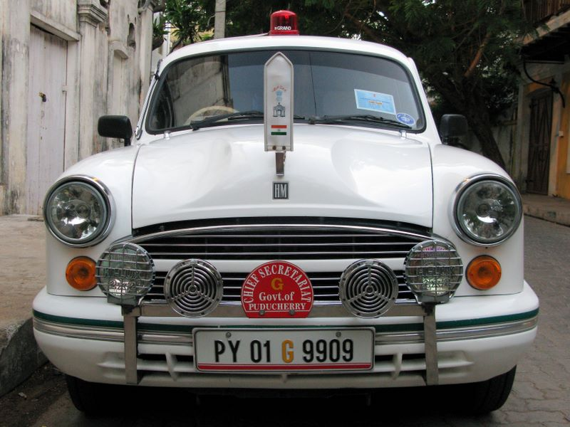 White Ambassador Cars Are Still Considered A Luxury Car In India